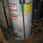 This is the new water heater, which our plumber thoughtfully installed rather quickly, leaving us without hot water only a couple days.